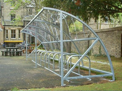 Alpine Galvanised Steel Cycle Shelter with Polycarbonate Roof - shown with cycle stands on racks