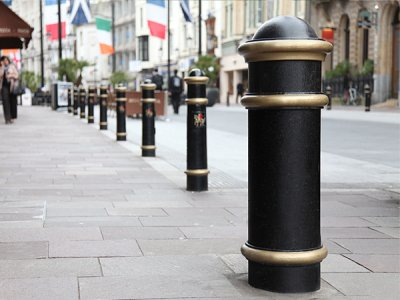 Cannon Secureplus bollard embellishment kit, shown with Cannon bollards with plaques,  Cardiff