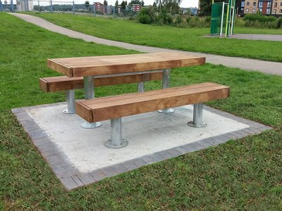 Elements 1850mm long x 810mm standard picnic table with large timber slats, timber fascias and steel galvanised post supports, shown with 2 benches