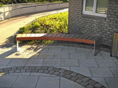 Variation Elements bench, bespoke curved with large timber slats and stainless steel plate ends