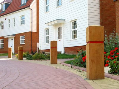 Epping Square Hardwood Timber Bollard with Groove - with red reflective tape, installed in Edenbridge, Kent
