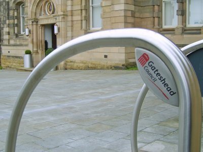 Fin cycle stands with branded corner plate