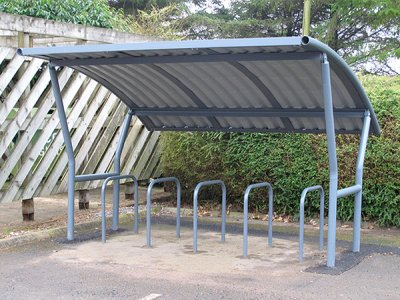 ACA800FP Academy cycle shelter powder coated with a plastisol coated roof, shown with College cycle stands,  Lancashire