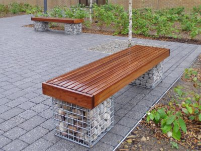 Elements 1.8m bench with small slats and timber fascias. Gabions filled with Scottish beach cobbles