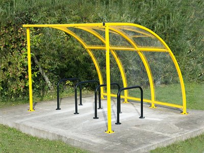 FIN3 ECO PPC Fin Eco cycle shelter with powder coated steel frame, shown with College cycle stands