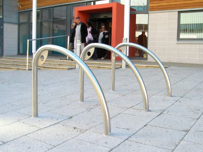 FIN600 S DCP Fin satin polished stainless steel cycle stands with decorative corner plate