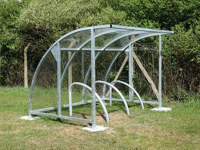 FIN800 F Fin cycle shelter with gavanised steel frame, shown with Fin cycle stands