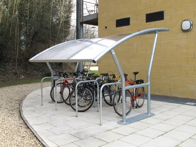 ACA800TP Academy galvanised steel cycle shelter with polycarbonate roof and College cycle stands, Oxford