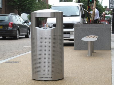 ZEN500 Zenith stainless steel perforated litter bin with cigarette stubber and ash waste liner, shown with the Zenith bench.