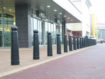 Gunner Security Cast Iron Bollard - painted black, installed at Gallagher Retail Park, Wednesbury