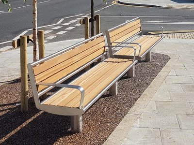 Horizon seats, stainless steel, iroko timber slats with end armrests, root fixed.