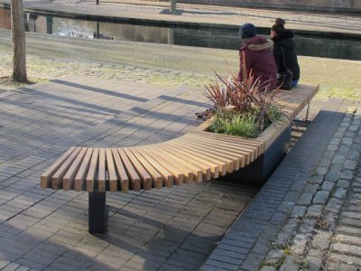 RailRoad 470mm high planter in mid-position of one curved bench and one straight bench.