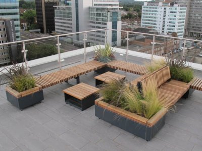 RailRoad RP2T 7070/47 freestanding 700mm square planters and 1400 x 700mm planters with bridge seating platforms and bespoke freestanding Hollo coffee tables.