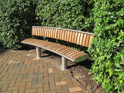 Zenith curved seat with external backrest, stainless steel with iroko timber slats