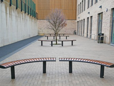 ZEN RB 186 Zenith curved benches, root fixed in PPC black with iroko timber slats - UV protective finish