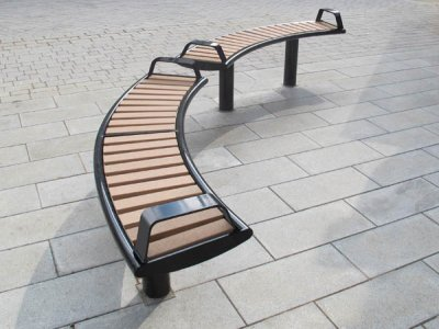 Horizon curved bench, PPC black with wood plastic composite (WPC) slats and end armrests