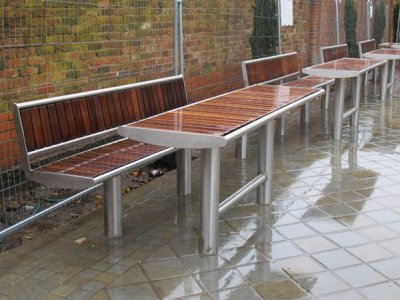 Zenith Horizon (special) picnic table and seat with front-to-back slats in stainless steel with iroko timbers