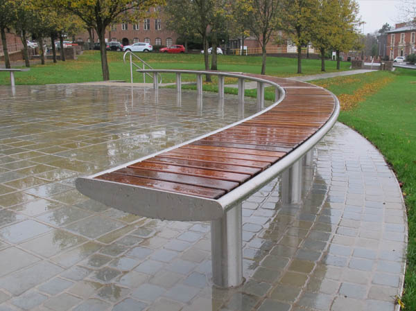 Horizon Curved Bench Special In Stainless Steel With Iroko Timber Slats